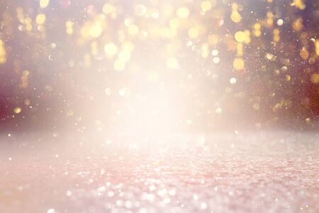 background of abstract glitter lights. gold and silver. de focused