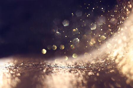 background of abstract glitter lights. gold and black. de focused Stok Fotoğraf