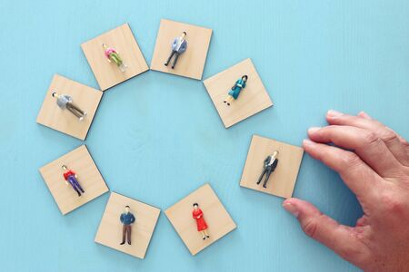 business concept image of people figures over wooden table, human resources and management concept 免版税图像