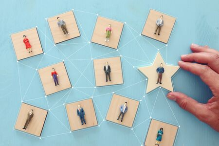 business concept image of people figures over wooden table, human resources and management concept Archivio Fotografico