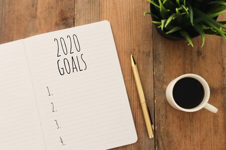 Business concept of top view 2020 goals list with notebook, cup of coffee over wooden desk Stock fotó - 132602091