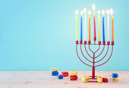 religion image of jewish holiday Hanukkah background with menorah (traditional candelabra) and spinning top Stock Photo