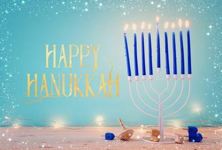 Religion image of jewish holiday Hanukkah background with menorah (traditional candelabra) and dreidels
