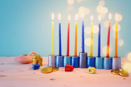 religion image of jewish holiday Hanukkah background with menorah (traditional candelabra) and spinning top