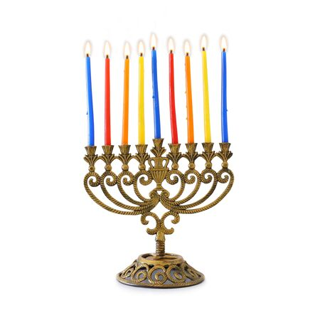 religion image of jewish holiday Hanukkah with brass menorah (traditional candelabra) and colorful candles isolated over white background
