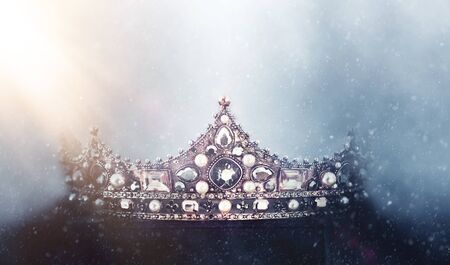 mysterious and magical photo of of beautiful queen/king crown over gothic snowy dark background. Medieval period concept Banque d'images