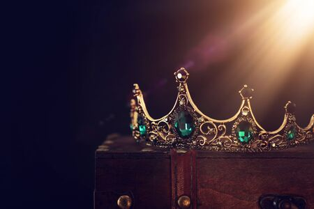low key image of beautiful queen/king crown over wooden table. vintage filtered. fantasy medieval period Banque d'images