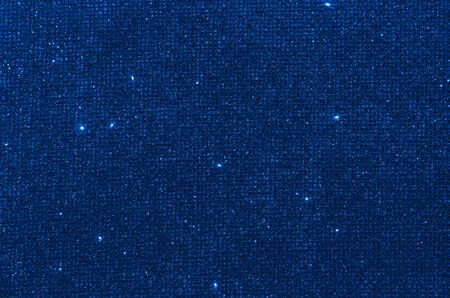 glitter classic blue lights background. de-focused. color of the year 2020