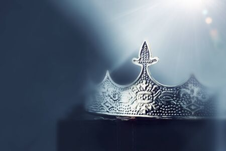 mysterious and magical photo of of beautiful queenking crown over gothic dark background. Medieval period concept