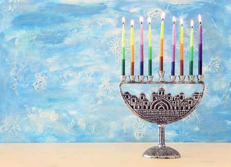 Religion image of jewish holiday Hanukkah background with brass menorah (traditional candelabra) and candles Stock Photo