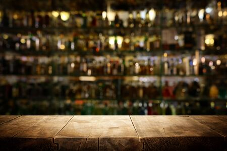 background Image of wooden table in front of abstract blurred restaurant lights Reklamní fotografie