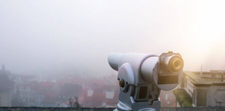 image of coin operated binoculars viewer in front of the urban landscape Banque d'images