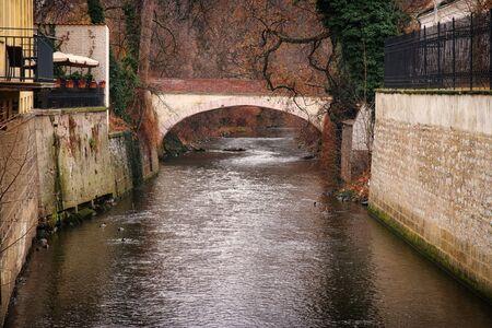 river with old brick bridge background