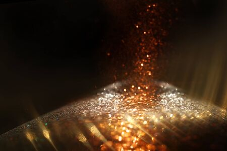 background of abstract glitter lights. gold and black. de focused Stock fotó
