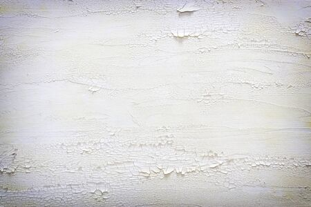 background of white wooden vintage wall with distressed, cracked and peeling details