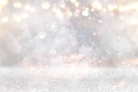 glitter vintage lights background. gold, silver and white. de-focused Reklamní fotografie