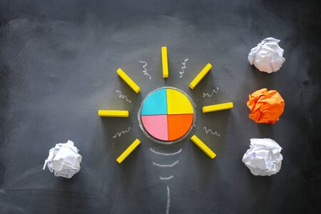 Education concept image. Creative idea and innovation. Tangram as light bulb metaphor over blackboard Stock fotó