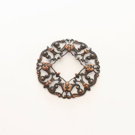 Cooper vintage Baroque Victorian filigree jewellery pedant isolated on white