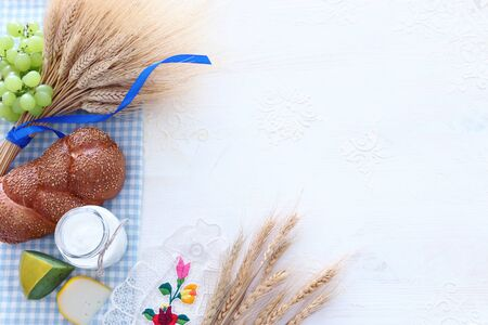 Top view photo of dairy products over white background. Symbols of jewish holiday - Shavuot
