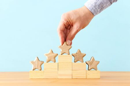 concept image of setting a five star goal. increase rating or ranking, evaluation and classification idea Reklamní fotografie