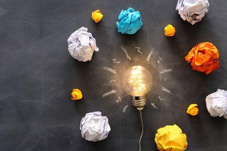 Education concept image. Creative idea and innovation. Light bulb as metaphor over blackboard Stock fotó