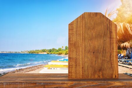background Image of wooden table in front of tropical beach. Ready for product display. Menu backdrop
