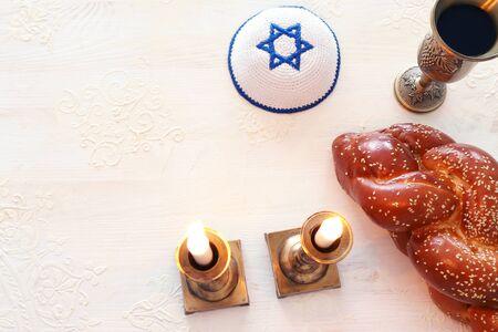 shabbat image. challah bread, shabbat wine and candles. Top view Stock Photo
