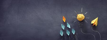 Education concept image. Creative idea and innovation. Crumpled paper as light bulb metaphor over blackboard Archivio Fotografico