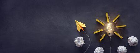 Education concept image. Creative idea and innovation. Light bulb as metaphor over blackboard