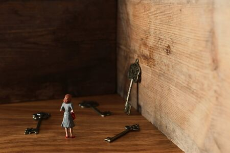 image of woman faces a dead end and is looking for the right key. concept of gender issues and problem solving