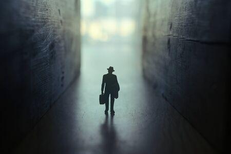 Businessman walks on an unknown road