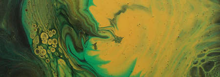 art photography of abstract marbleized effect background. Gold and balck, green creative colors. Beautiful paint.
