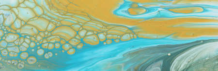 art photography of abstract marbleized effect background. Blue and gold creative colors. Beautiful paint.