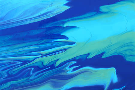 art photography of abstract marbleized effect background. Blue and mint creative colors. Beautiful paint.