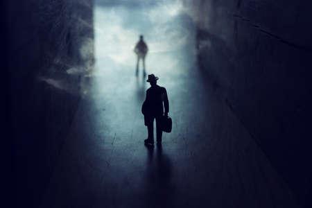 Businessman walks on an unknown road with smoke Archivio Fotografico