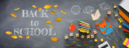 education. Back to school concept over blackboard background. top view, flat lay
