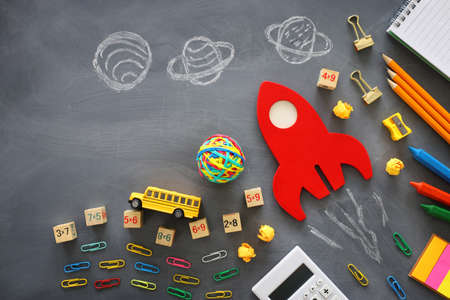 education. Back to school concept. wooden red rocket over blackboard background. top view, flat lay Archivio Fotografico - 150986908