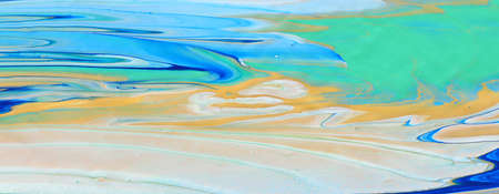 art photography of abstract marbleized effect background. Blue, white and gold creative colors. Beautiful paint.