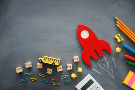 education. Back to school concept. wooden red rocket over blackboard background. top view, flat lay Archivio Fotografico - 150988904