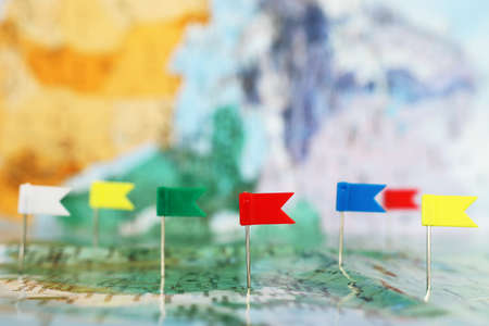 pins attached to map, showing location or travel destination . retro style image. selective focus