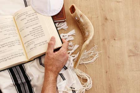 religion image of Prayer book and Shofar (horn) jewish religious symbols. Rosh hashanah (jewish New Year holiday), Shabbat and Yom kippur concept Reklamní fotografie