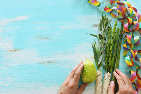Jewish festival of Sukkot. Traditional symbols (The four species): Etrog (citron), lulav (palm branch), hadas (myrtle), arava (willow)