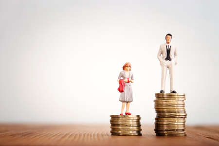 Conceptual image of gender inequality. A woman and a man with income difference
