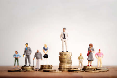 Conceptual image of gender inequality. A women and a men with income difference