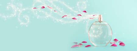 Image of elegant perfume bottle spraying over blue pastel background