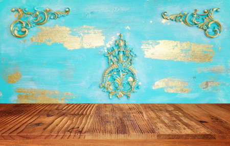 background Image of wooden vintage table in front of decorative oriental wall. ready for product display