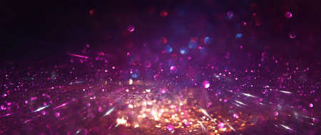 background of abstract glitter lights. gold, black and purple. de focused Standard-Bild