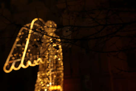Abstract and bokeh background of luminous angel figure with christmas lights Archivio Fotografico