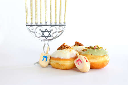 Banner of jewish holiday Hanukkah with doughnut and wooden dreidels (spinning top)