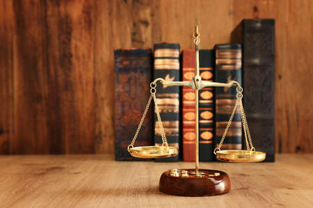 Vintage law scale over wooden table